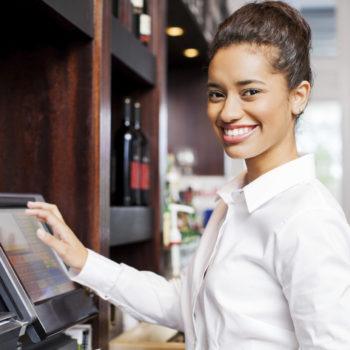 Waitress Preparing Bill At Cash Register In Restaurant